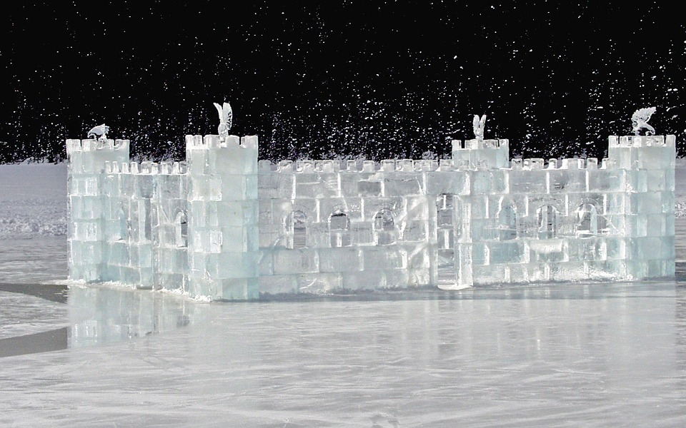 Ice castle on frozen Lake Louise at the incredible fairytale Fairmont Chateau